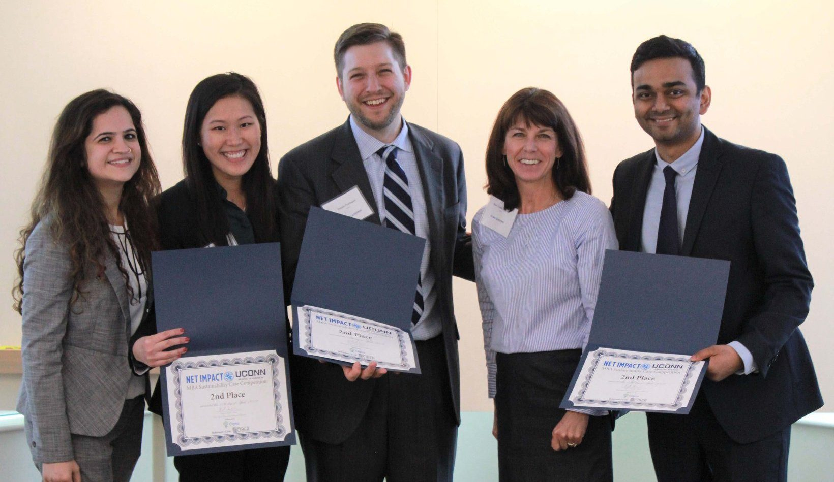 students pose with certificates after case competition